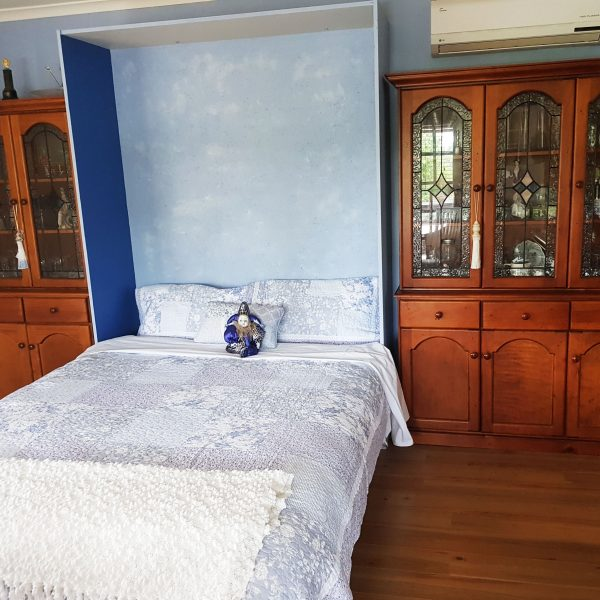 Inside-photo-with-2-wooden-dressers-and-bed