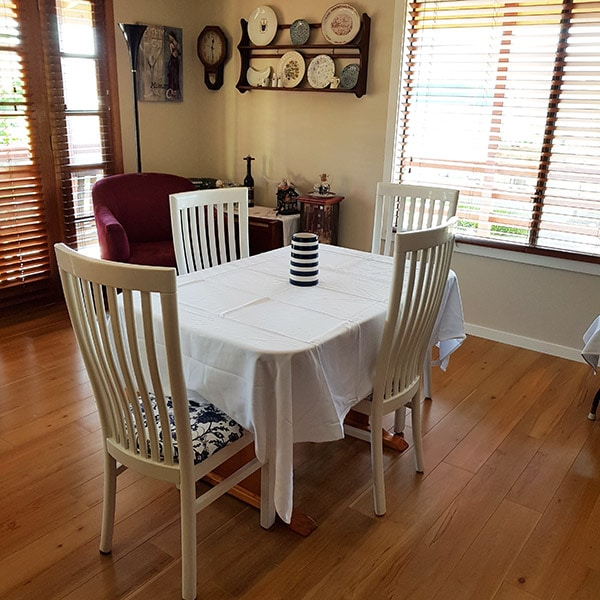Dining area with white table cloth