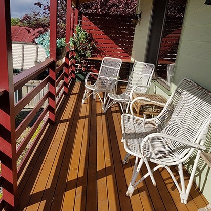 Shot-of-complete-red-deck-with-nice-white-chairs
